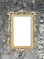 Close-up of one golden baroque picture frame on weathered wall background