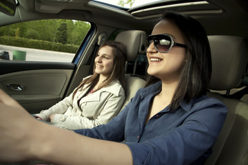 Two Young Woman At Car