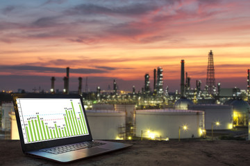 Industry business concept idea, laptop on wooden table with oil