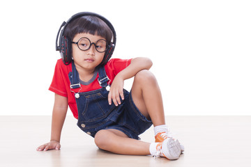 Little boy with headphones on the head listening to the music