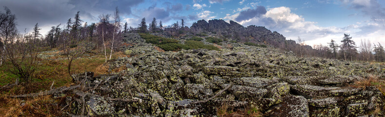 Spring panorama of a rocky ridge with stone talus