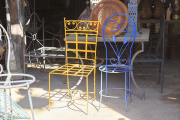 Vintage iron chairs at blacksmith shop in Marrakech
