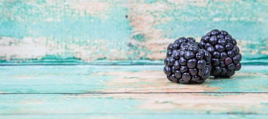 Blackberry fruit over wooden background Wall mural