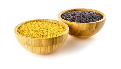 Vibrant yellow mustard with dark black mustard seeds