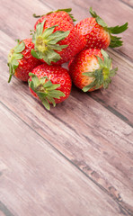 Strawberry fruit over wooden background