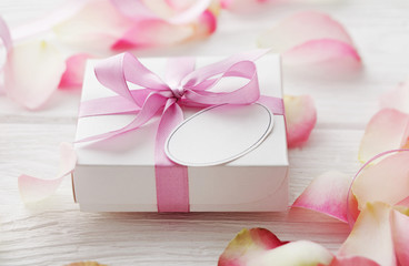 gift box with blank gift tag and flower petals