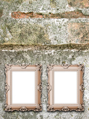 Close-up of two baroque picture frames on weathered wall background
