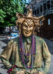 New Orleans French Quarter Street Performer in Mardi Gras Mask
