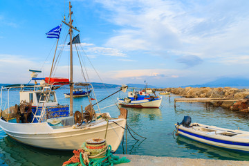 Traditional Greek fishing boats in port at sunset time, Samos island, Greece