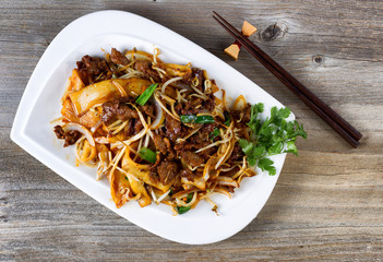 Chinese spicy beef dish in plate setting ready to eat