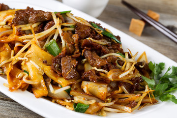 Chinese spicy beef and vegetable dish in plate