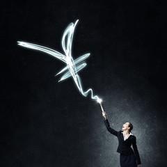 Woman drawing with lantern light