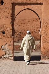 Old man entering a doorway in Morocco