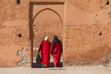 Muslim women entering a doorway in Morocco
