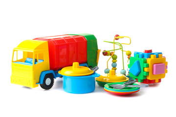 collection of bright toys on wooden table on a white isolated background
