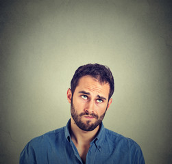 funny confused skeptical man thinking looking up