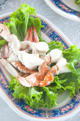 Fresh and delicious steamed or boiled crabs legs Thai style, sea