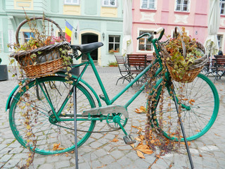 Old Bicycle Equipped with Basket in Sighisoara citadel central s