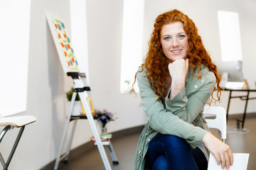 Young female artist with her picture