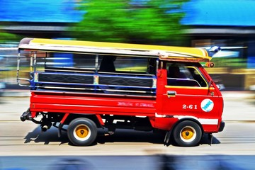 tuk-tuk car from Thailand, in motion blur