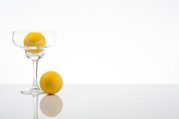 tennis ball in a transparent glass