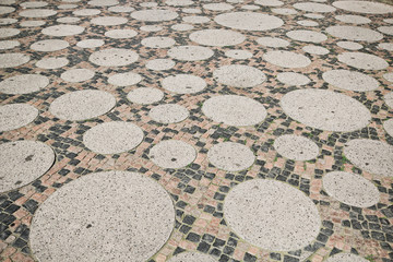 Cobblestone patern on the square near the Kaiser Wilhelm Memorial Church in Berlin, Germany.