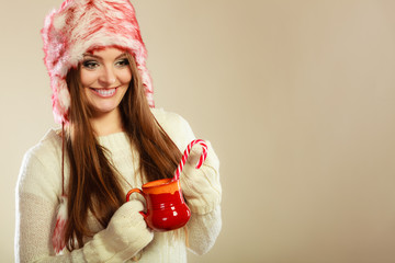 Girl with cane in xmas mug.