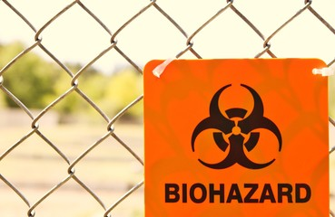 Bio hazard. Bio hazard sign on a chain link fence boundary. .