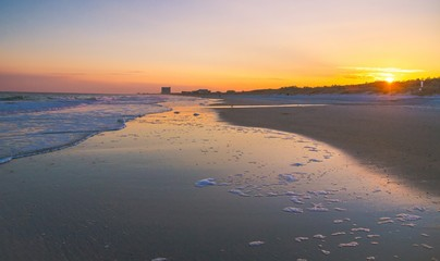 Myrtle Beach Sunset. Sunset on a wide Atlantic Ocean beach with the popular resort town of Myrtle Beach, South Carolina in the background.