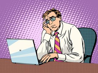 Businessman working on laptop boredom