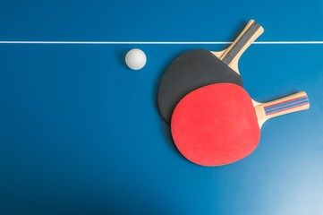Ping pong or table tennis background with rackets