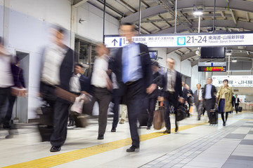Business people traveling by Tokyo metro.