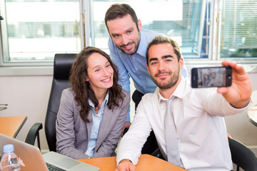 Group of business associates working together at the office