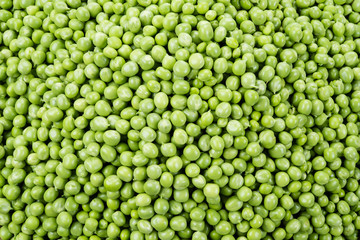 Fresh peas. Green background.