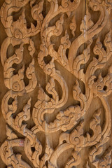 Carved wooden latticework with pattern of thai stlye
