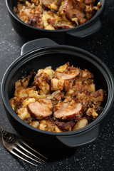 Potatoes baked with sausage and bacon