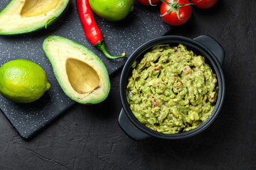 Bowl of guacamole with fresh ingredients