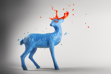 Blue paint sculpture magic deer with melting horns
