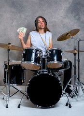 musician with his black drum set with his salary