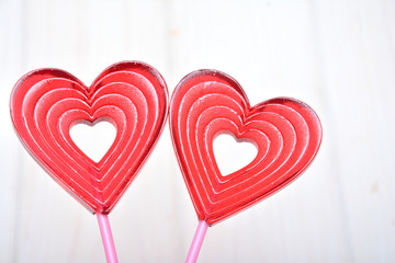 Lollipops in the shape of the heart on a white background