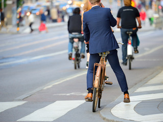 Fototapete - Man in perfect suit with phone and old bike, typical Stockholm Scene