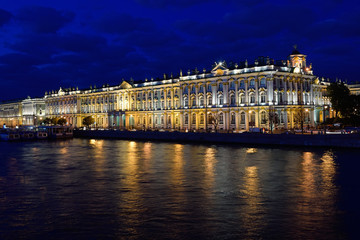 The winter Palace illuminated , reflection in the water
