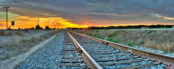 Foto op Textielframe Spoorlijn Panoramic view of railroad tracks crossing the frame from right to left.