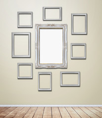 Silver Frame decor on wallpaper with light flare.