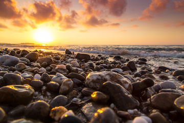 A beautiful beach on a Greek island in summer, under warm evening light