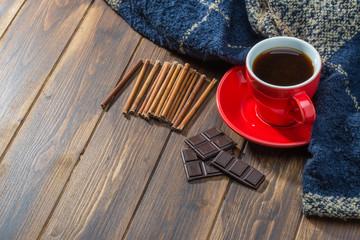 Coffee and blanket on wooden floor, warm