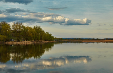 Beautiful Volga landscape, clouds are reflected in water