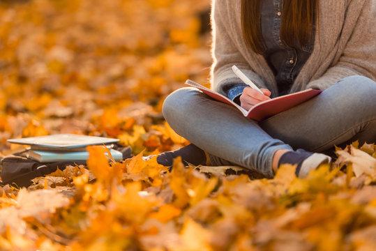 Student in autumn park