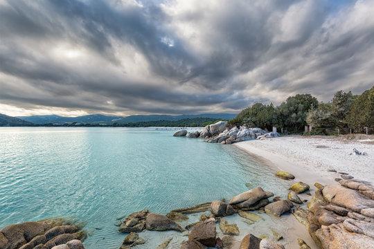 Boulders in a turquoise sea at Santa Giulia beach in Corsica