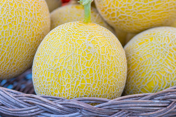 Yellow Melon in the basket on market, selective focus